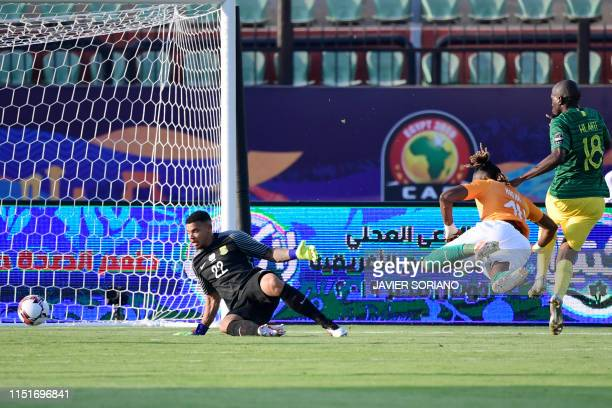 TOPSHOT Ivory Coast's forward Jonathan Kodjia scores a goal in front of South Africa's goalkeeper Rowen Williams during the 2019 Africa Cup of...