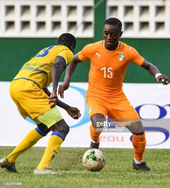 Ivory Coast's forward Max Gradel vies for the ball with Rwanda's Fitina Omborenga during the 2019 African Cup of Nations Group H qualification...