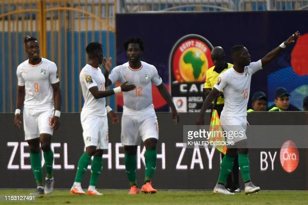 Ivory Coast's forward MaxAlain Gradel celebrates his goal with teammates during the 2019 Africa Cup of Nations Group D football match between Namibia...