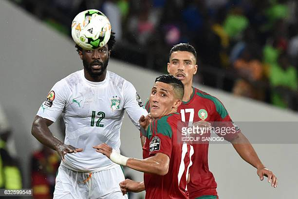 TOPSHOT Ivory Coast's forward Wilfried Bony challenges Morocco's midfielders Faycal Fajr and Nabil Dirar during the 2017 Africa Cup of Nations group...