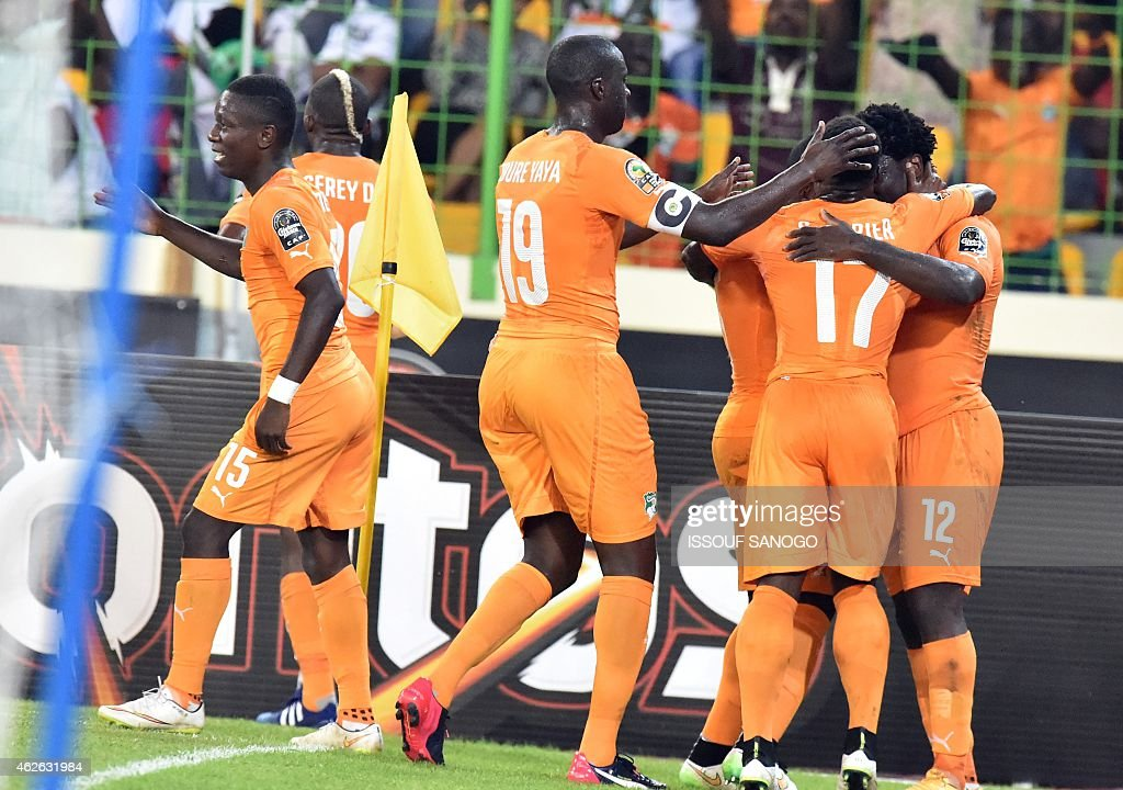 Ivory Coast's forward Wilfried Bony (R) is congratulated by teammates after scoring a goal during the 2015 African Cup of Nations quarter final football match between Ivory Coast and Algeria in Malabo, on February 1, 2015.