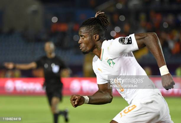Ivory Coast's forward Wilfried Zaha celebrates after scoring a goal during the 2019 Africa Cup of Nations Round of 16 football match between Ivory...