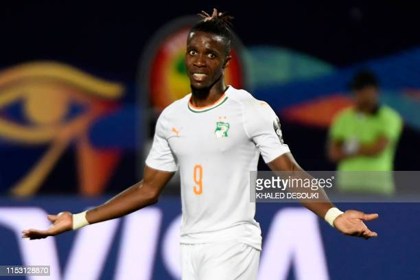 Ivory Coast's forward Wilfried Zaha reacts during the 2019 Africa Cup of Nations Group D football match between Namibia and Ivory Coast at the 30...