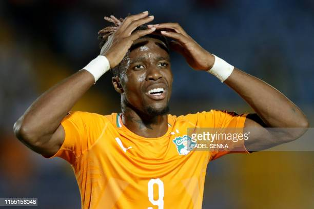 Ivory Coast's forward Wilfried Zaha reacts during the 2019 Africa Cup of Nations quarter final football match between Ivory Coast and Algeria at the...