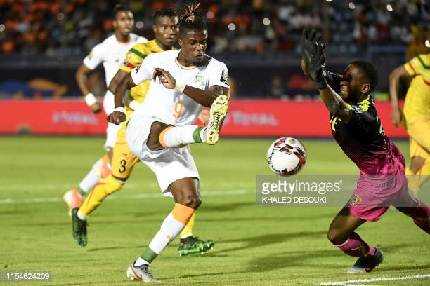 Ivory Coast's forward Wilfried Zaha scores a goal during the 2019 Africa Cup of Nations Round of 16 football match between Ivory Coast and Mali at...