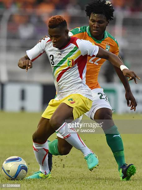 Ivory Coast's Franck Kassier vies with Mali's Youssouf Kone during the FIFA World Cup 2018 football qualification match between Ivory Coast and Mali...