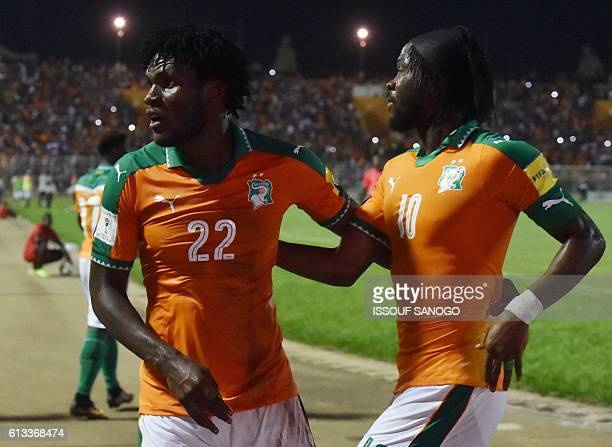 Ivory Coast's Franck Kessie and Gervinho celebrate after scoring during the World Cup 2018 football qualification match between Ivory Coast and Mali...
