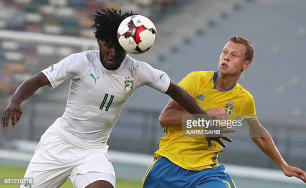 Ivory Coast's Franck Kessie vies for the ball with Sweden's Viktor Claesson during the International friendly football match between Sweden and Ivory...