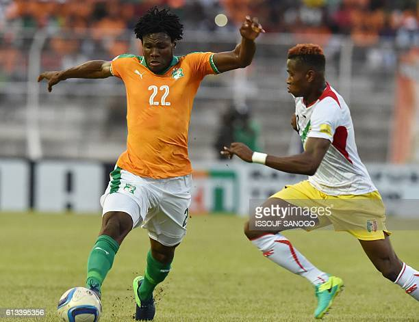 Ivory Coast's Franck Kessie vies with Mali's Youssouf Kone during the FIFA World Cup 2018 football qualification match between Ivory Coast and Mali...