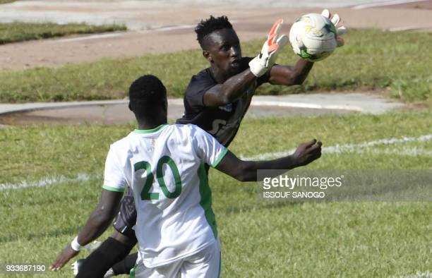 Ivory Coast's goalkeeper Abdoul Karim Cisse catches the ball in front of Zambia's Lameck Banda during the Confederation of African Football Champions...
