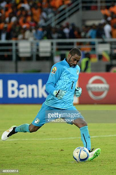 Ivory Coast's goalkeeper Boubacar Barry kicks the winning penalty during the penalty shootout of the 2015 African Cup of Nations final football match...