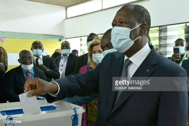 Ivory Coast's incumbent President and presidential candidate Alassane Ouattara casts his ballot at a polling station in Abidjan on October 31 during...