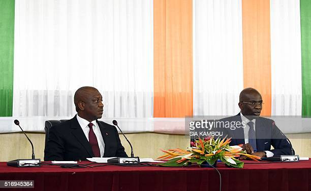 Ivory Coast's Interior Minister Hamed Bakayoko and Ivory Coast prosecutor Adou Richard Christophe attend a press conference in Abidjan on March 22...
