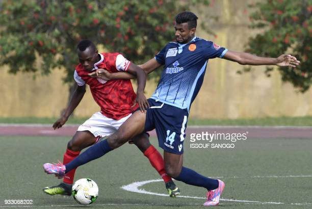 Ivory Coast's JeanFrancis Kouadio vies with Morocco's Haddadi Faissal during the CAF Champions league football match between Williamsville Athletic...