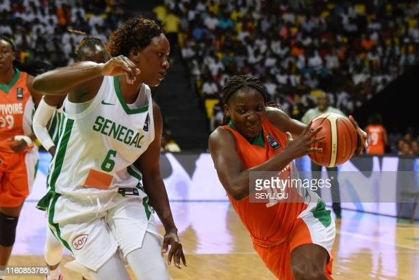 Ivory Coast's Kani Kouyate runs with the ball during the FIBA Women's AfroBasket 2019 Group Phase A basketball match between Senegal and Ivory Coast...