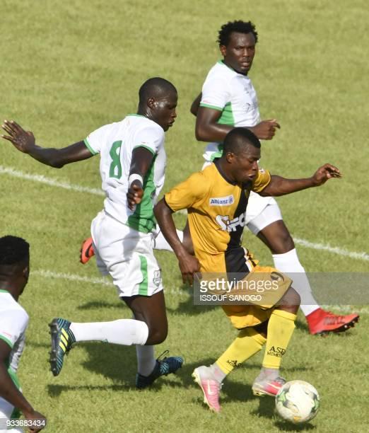 Ivory Coast's Komlan Agbegniadan vies with Zambia's Davida Owino and Antho Akumu during the Confederation of African Football Champions League match...