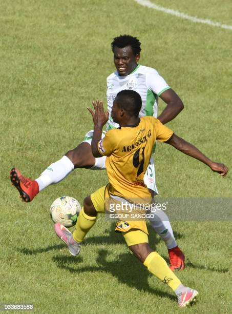 Ivory Coast's Komlan Agbegniadan vies with Zambia's Davida Owino during the Confederation of African Football Champions League match between Asec...