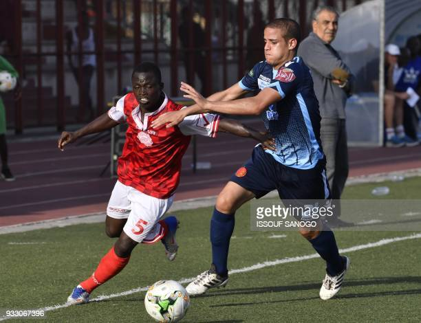 Ivory Coast's Kouassi Yao vies with Morocco's Rachid Housni during the CAF Champions league football match between Williamsville Athletic Club and...