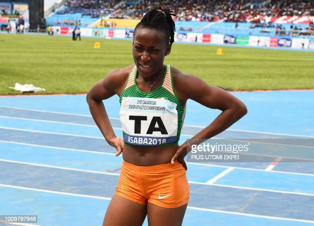 Ivory Coast's MarieJosee Ta Lou reacts after victory in the women's 100 metres during The 21st African Athletics Championships at The Stephen Keshi...