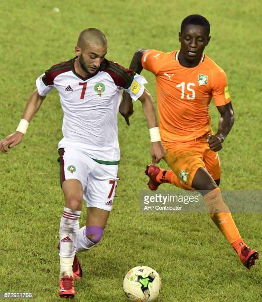 Ivory Coast's Max Gradel vies with Morocco's Hakim Ziyach during the FIFA World Cup 2018 Africa Group C qualifying football match between Ivory Coast...