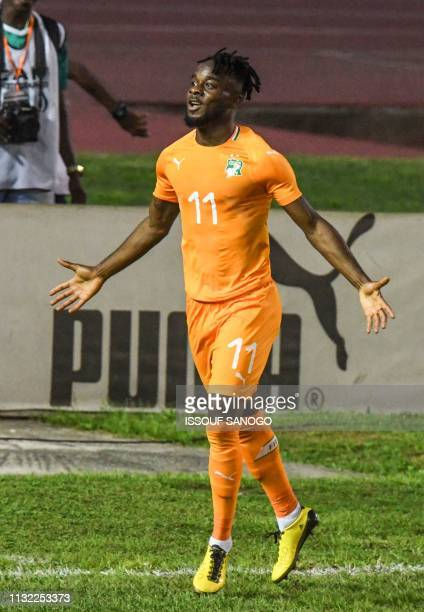 Ivory Coast's Maxewel Cornet celebrates after scoring a goal during the 2019 African Cup of Nations Group H qualification football match between...