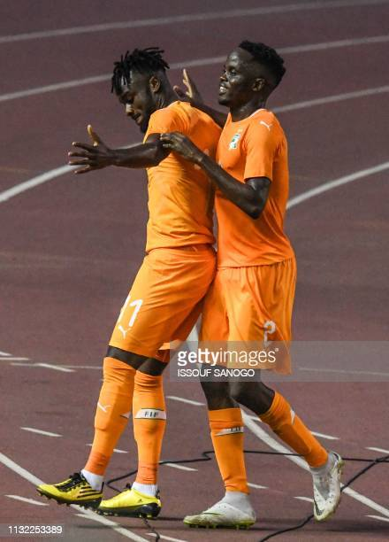 Ivory Coast's Maxewel Cornet celebrates with a team mate after scoring a goal during the 2019 African Cup of Nations Group H qualification football...