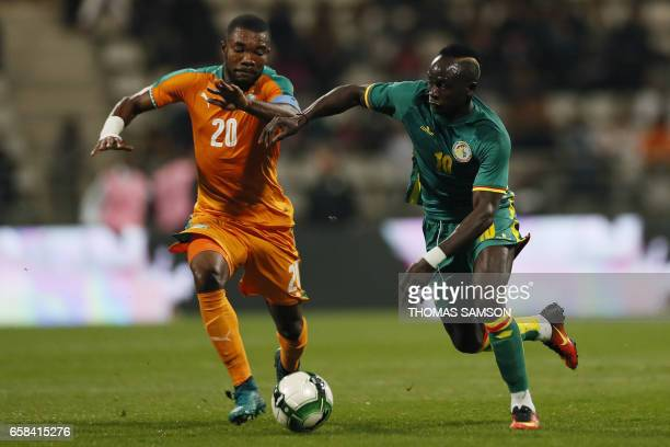 Ivory Coast's midfielder Die Geoffroy Serey vies with Senegal's forward Sadio Mane during the friendly football match Ivory Coast vs Senegal on March...