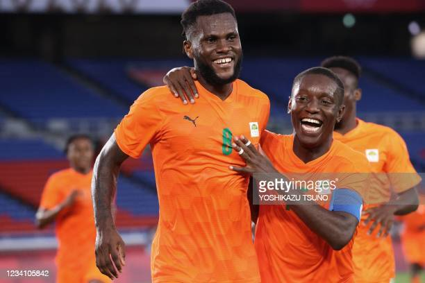 Ivory Coast's midfielder Franck Kessie celebrates with Ivory Coast's forward Max Gradel after he scored his side's second goal during the Tokyo 2020...