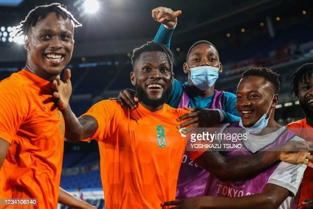 Ivory Coast's midfielder Franck Kessie celebrates with Ivory Coast's forward Christian Kouame and teammates after he scored his side's second goal...