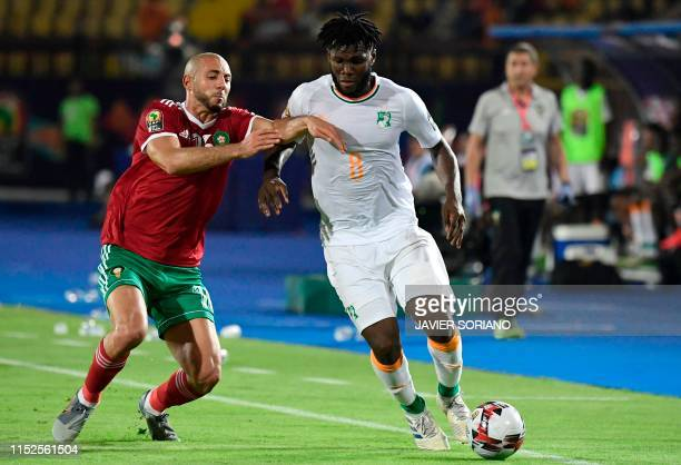 Ivory Coast's midfielder Franck Kessie is marked by Morocco's forward Nordin Amrabat during the 2019 Africa Cup of Nations Group D football match...