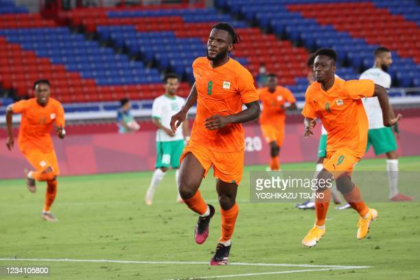 Ivory Coast's midfielder Franck Kessie reacts after he scored his side's second goal during the Tokyo 2020 Olympic Games men's group D first round...