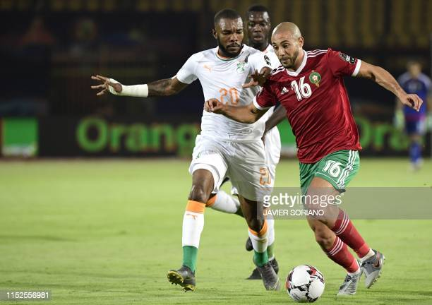 Ivory Coast's midfielder Geoffrey Serey Die vies for the ball with Morocco's forward Nordin Amrabat during the 2019 Africa Cup of Nations Group D...