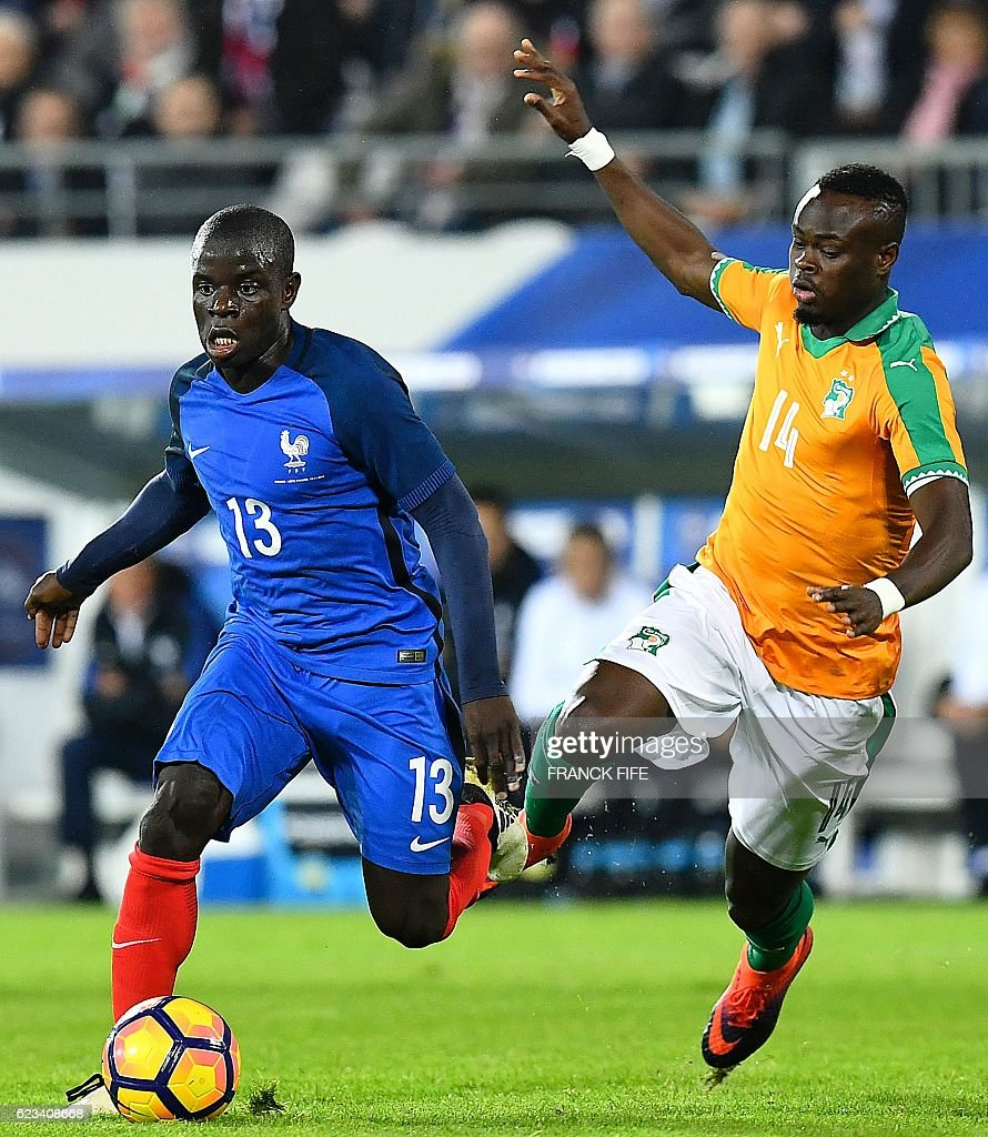 Ivory Coast's midfielder Ismael Diomande (R) vies with France's midfielder N'Golo Kante during the friendly football match France vs Ivory Coast on November 15, 2016 at the Bollaert stadium in Lens. / AFP / FRANCK