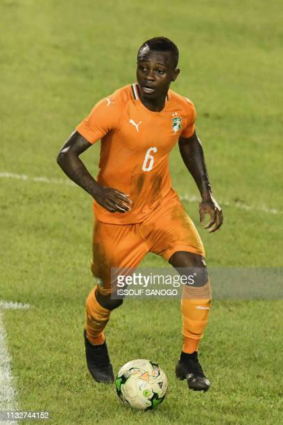 Ivory Coast's midfielder Jean Michael Seri plays the ball during the 2019 African Cup of Nations Group H qualification football match between Ivory...