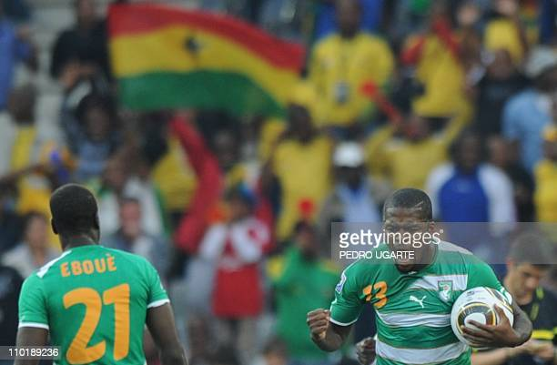 Ivory Coast's midfielder Romaric celebrates near Ivory Coast's defender Emmanuel Eboue after scoring a goal during their Group G first round 2010...
