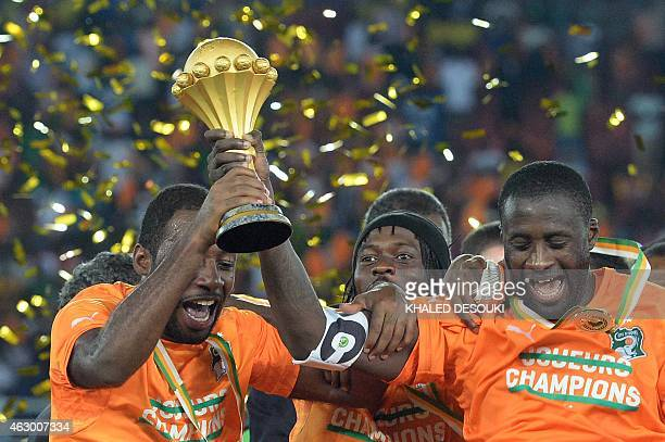 Ivory Coast's midfielder Yaya Toure holds the trophy at the end of the 2015 African Cup of Nations final football match between Ivory Coast and Ghana...