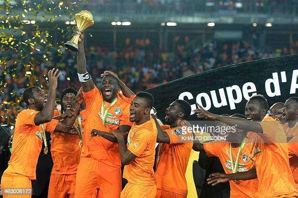 Ivory Coast's midfielder Yaya Toure raises the trophy at the end of the 2015 African Cup of Nations final football match between Ivory Coast and...