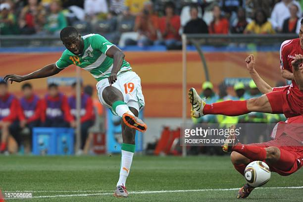 Ivory Coast's midfielder Yaya Toure shoots and scores a goal during their Group G first round 2010 World Cup football match on June 25 2010 at...