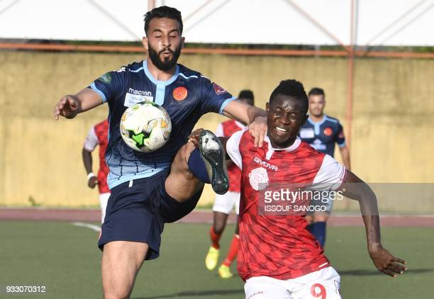 Ivory Coast's Mofosse Tresore Karidioula vies with Morocco's Haddadi Faissal during the CAF Champions league football match between Williamsville...