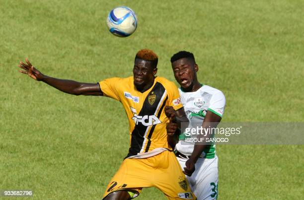 Ivory Coast's Mohamed Lamine Ndao vies with Zambia's Fackson Kapumbu during their Confederation of African Football Champions League match between...