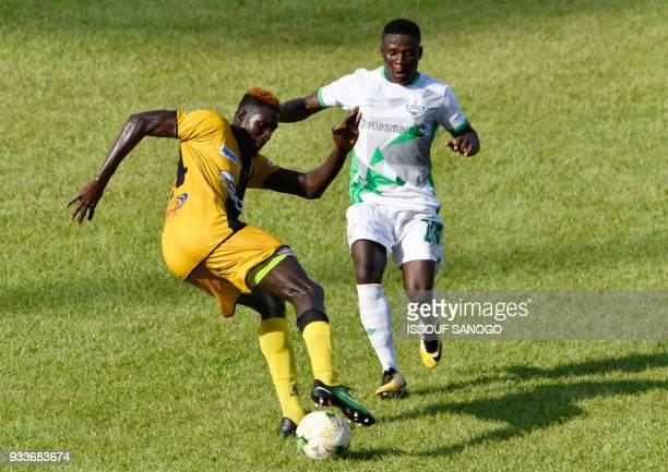 Ivory Coast's Mohamed Lamine Ndao vies with Zambia's Lazarous Lameck Banda during the Confederation of African Football Champions League match...