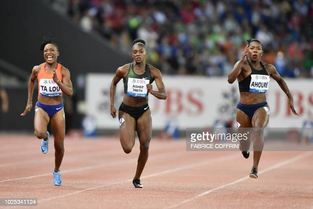 Ivory Coast's Murielle Ahoure competes and wins ahead of secondplaced Britain's Dina AsherSmith and thirdplaced Ivory Coast's Marie Josee Ta Lou in...