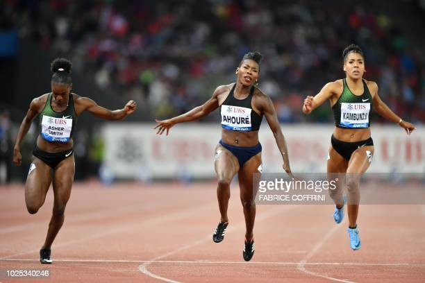 Ivory Coast's Murielle Ahoure wins ahead of ahead of secondplaced Britain's Dina AsherSmith and fourthplaced Switzerland's Mujinga Kambundji in the...