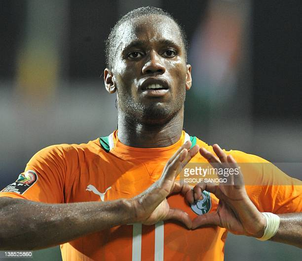 Ivory Coast's national football team captain Didier Drogba greets supporters after their victory against Mali at the stade de l'amitie in Libreville...