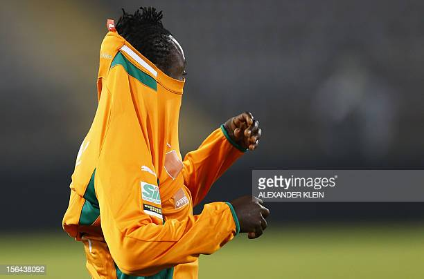Ivory Coast's national football team player Arthur Boka attends a training session on the eve of the friendly football match between Ivory Coast and...