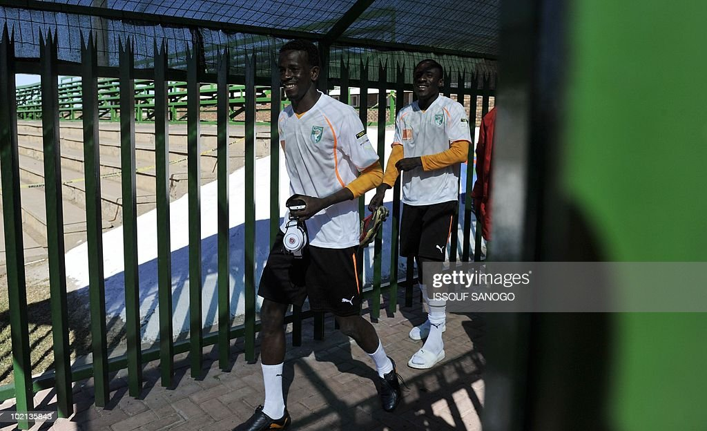 Ivory Coast's national football team players Emmanuel Kone (L) and Seydou Doumbia arrive for a training session on June 16, 2010 in Sharpeville, a day after their first 2010 World Cup tournament match against Portugal.