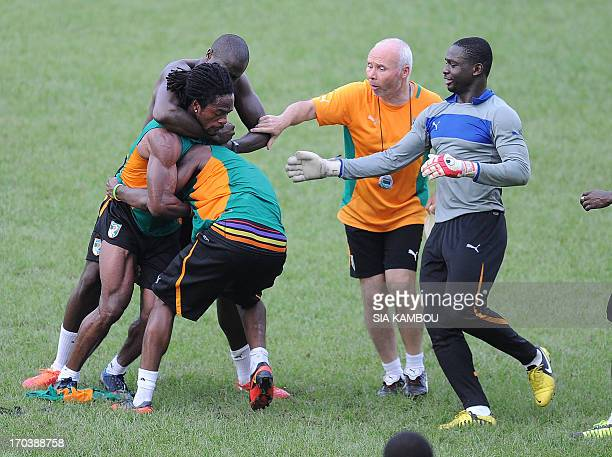 Ivory Coast's national football team players Gossio Gossio and Abdul Razak fight during a training session on June 12 2013 at the Felix Houphouet...