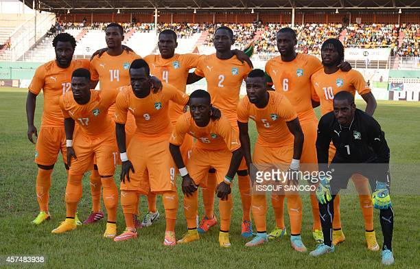 Ivory Coast's National football team players pose at the Felix HouphouetBoigny stadium in Abidjan on October 15 2014 during a African Cup of Nations...