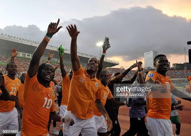 Ivory Coast's National football team players Salomon Kalou Gervais Kouassi Yao Didier Drogba Kouamatine Kone and Ndri Koffi Romaric celebrate their...