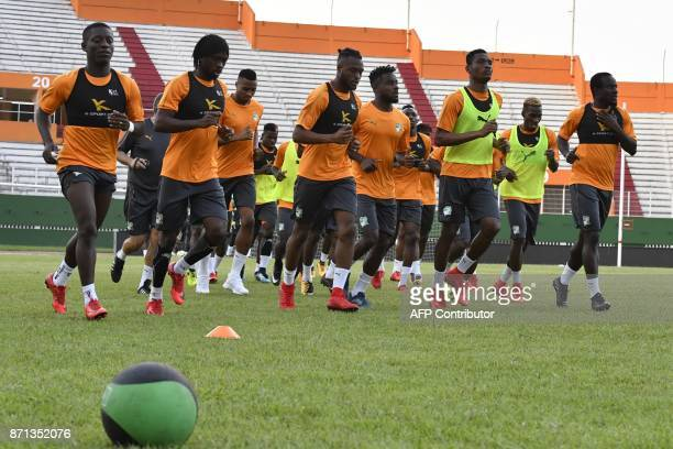 Ivory Coast's national team players run during a training session on November 7 2017 at the Felix HouphouetBoigny stadium in Abidjan ahead of the...
